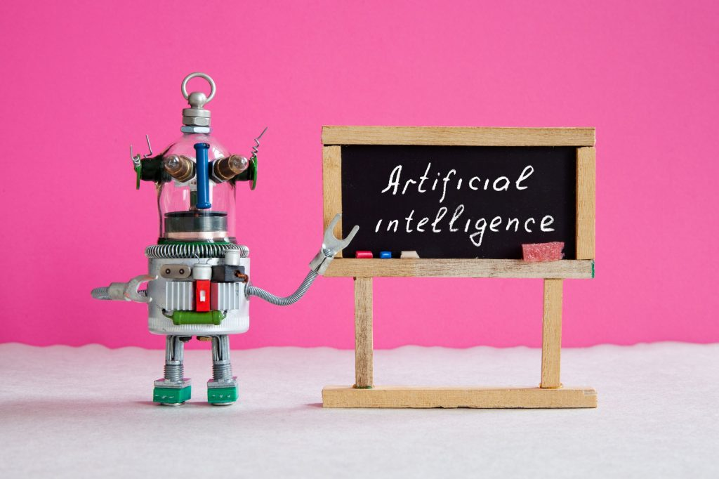 toy robot using a blackboard to explain artificial intelligence