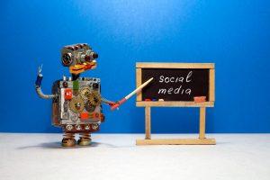 toy robot using a blackboard to explain social media