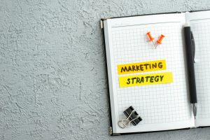 open notebook with 'marketing strategy' highlighted